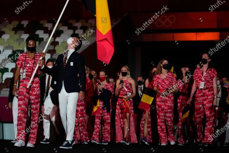 Stock Photo of Nafissatou Thiam and Felix Veronique B. Denayer, of Belgium, carry their country's flag during the opening ceremony in the Olympic Stadium at the 2020 Summer Olympics, in Tokyo, Japan