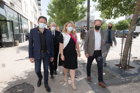 Stock Photo of Nadia Hai's delegate minister in charge of the City on the theme of prevention battalions. Wandering in the Gresilles district with Didier Martin MP for LREM for Cote d'Or and Remi Delatte MP LR for Côte d'Or