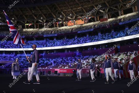 Hannah Mills and Mohamed Sbihi, of Britain, carry their country's flag arrives during the opening ceremony in the Olympic Stadium at the 2020 Summer Olympics, in Tokyo, Japan