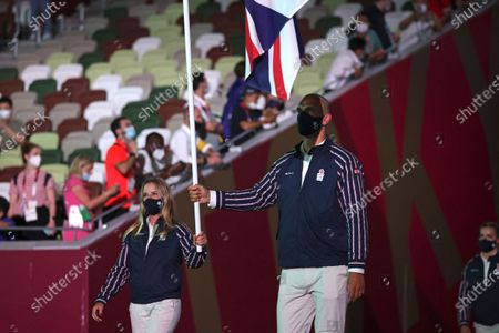 Stock Picture of Hannah Mills and Mohamed Sbihi, of Britain, carry their country's flag during the opening ceremony in the Olympic Stadium at the 2020 Summer Olympics, in Tokyo, Japan
