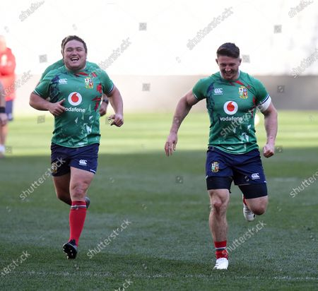 Jamie George (centre) - British & Irish Lions hooker races Tom Curry (R) during the warm up.