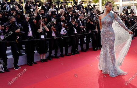 Maeva Coucke poses for photographers upon arrival at the premiere of the film 'Benedetta' at the 74th international film festival, Cannes, southern France