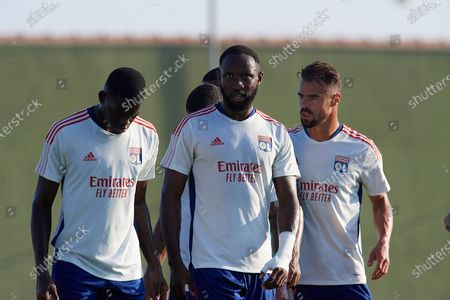 Stock Picture of (L-R) Castello Lukeba, Moussa Dembele and Damien Da Silva of Olympique Lyonnais during the warm-up before the pre-season friendly match between Olympique Lyonnais and Villarreal CF at Pinatar Arena on July 21, 2021 in Murcia, Spain.