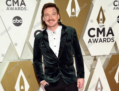 """Morgan Wallen arrives at the 53rd annual CMA Awards on Nov. 13, 2019, in Nashville, Tenn. Wallen said it was ignorant of him to use a racial slur. In his first interview in six months, Wallen talked to Michael Strahan on ABC's """"Good Morning America."""" on"""