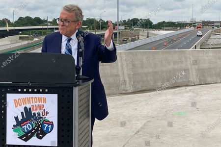 Ohio Gov. Mike DeWine promotes a new entrance ramp onto I-70 in downtown Columbus, Ohio. Facing growing vaccine hesitancy, governors in states hard hit by the coronavirus pandemic are asking federal regulators to grant full approval to the shots in the hope that will persuade more people to get them. The governors of Arkansas and Ohio have appealed in recent days for full approval as virus cases and hospitalizations skyrocket in their states