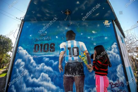 A view of a mural dedicated to late Diego A. Maradona in Lomas de Marilo neighborhood in the town of Bella Vista, Buenos Aires province, Argentina, 21 July 2021 (issued 23 July 2021). A few less than eight months after the death of Diego Maradona, residents of the neighborhood where he was buried told Efe that the area experiences a great 'revolution', both artistic and commercial, and that, still deceased, the soccer star continues to give them joy.