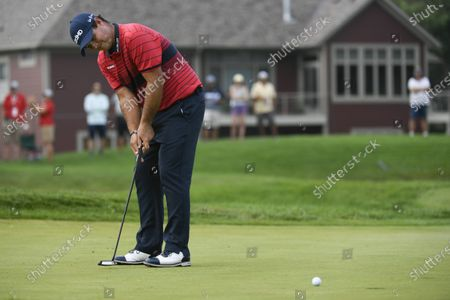 Stock Image of Patrick Reed hits a putt on the seventh hole during the first round of the 3M Open golf tournament in Blaine, Minn