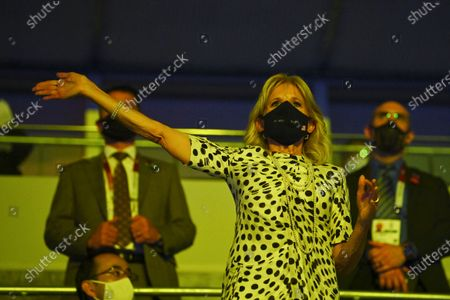 First lady of the United States Jill Biden waves during the opening ceremony in the Olympic Stadium at the 2020 Summer Olympics, in Tokyo, Japan