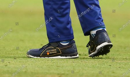 Stock Picture of The personalised bowling spikes of Mohammad Amir of London Spirit with a message