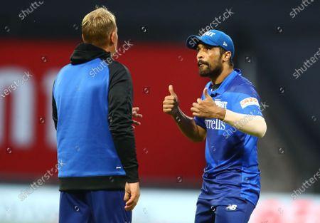 Mohammad Amir of London Spirit speaks with London Spirit head coach Shane Warne