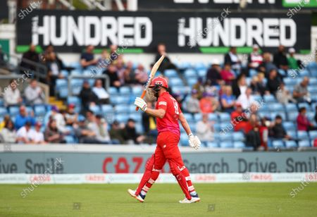 Jonny Bairstow of Welsh Fire holds up his bat after losing his wicket