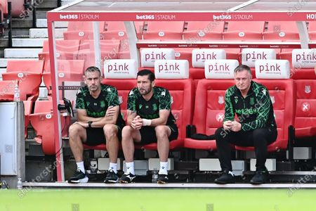 Michael O'Neill manager of Stoke City looks on.