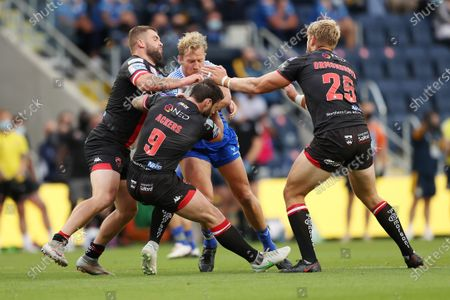 Leeds Rhinos' Matt Prior in action with Salford Red Devils' Ryan Lannon, Andy Ackers and Jack Ormondroyd