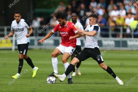 Stock Image of Tom Lawrence of Derby tackles Jason Lowe of Salford City
