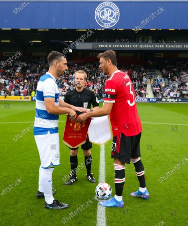 Lee Wallace of QPR  & Nemanja Matic of Manchester United exchange club pennants during the coin toss