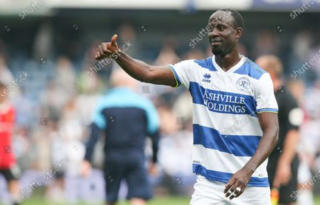 Albert Adomah of QPR celebrates and applauds supporters after victory