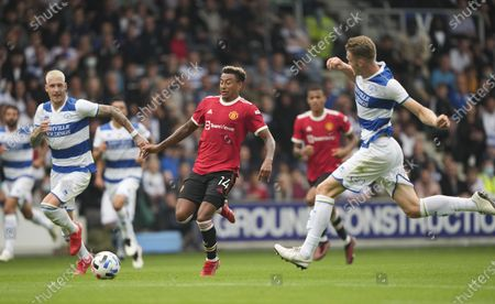 Jesse Lingard of Manchester United is marked by Rob Dickie and Jordy de Wijs of QPR