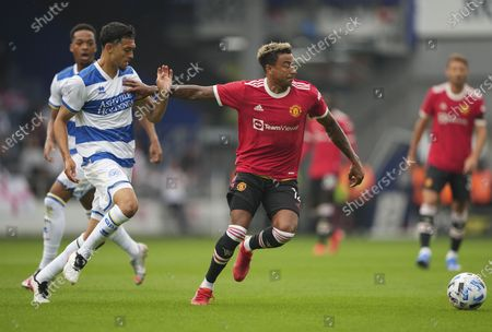 Jesse Lingard of Manchester United and Andre Dozzell of QPR