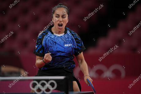 Chile's Maria Paulina Vega reacts during the table tennis women's singles first round match against Mongolia's Bolorerdene Batmunkh at the 2020 Summer Olympics, in Tokyo