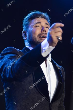 Stock Photo of Singer Miguel Poveda performs live on stage during the Jazz Palacio Real 'music festival at Palacio Real in Madrid.