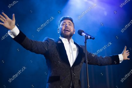 Stock Image of Singer Miguel Poveda performs live on stage during the Jazz Palacio Real 'music festival at Palacio Real in Madrid.