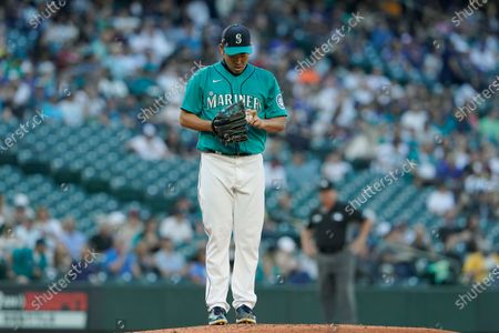 Seattle Mariners starting pitcher Yusei Kikuchi stands on the mound after he gave up a solo home run to Oakland Athletics' Matt Chapman during the third inning of a baseball game, in Seattle