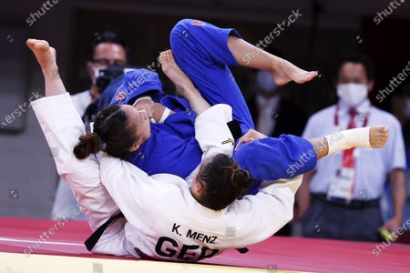 Katharina Menz (white) in action against Mary Dee Vargas Ley of Chile during their bout in the Women -48 kg Elimination Round of 32 at Judo competitions of the Tokyo 2020 Olympic Games at the Nippon Budokan arena in Tokyo, Japan, 24 July 2021.