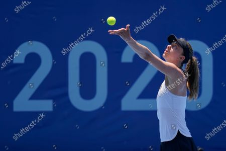 Mona Barthel, of Germany, serves to Iga Swiatek, of Poland, during the tennis competition at the 2020 Summer Olympics, in Tokyo, Japan