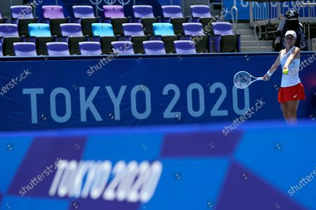 Iga Swiatek, of Poland, serves to Mona Barthel, of Germany, during the tennis competition at the 2020 Summer Olympics, in Tokyo, Japan