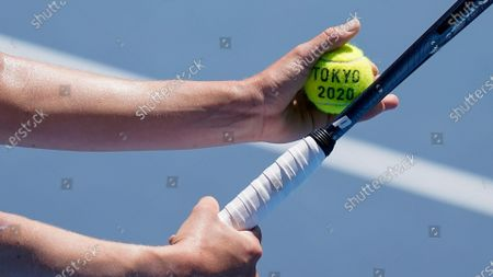 Mona Barthel, of Germany, prepares to serve to Iga Swiatek, of Poland, during the tennis competition at the 2020 Summer Olympics, in Tokyo, Japan