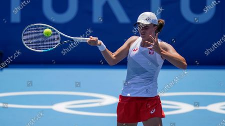 Iga Swiatek, of Poland, returns to Mona Barthel, of Germany, during the tennis competition at the 2020 Summer Olympics, in Tokyo, Japan