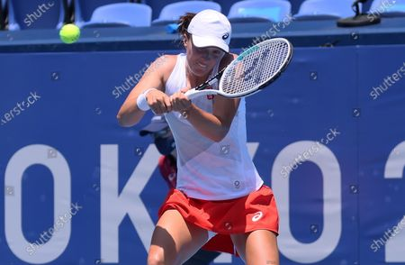 Iga Swiatek of Poland in action against Mona Barthel of Germany during the women's singles first round match of the Tokyo 2020 Olympic Games in Tokyo, Japan, 24 July 2021.