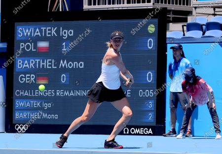 Mona Barthel of Germany in action against Iga Swiatek of Poland during the women's singles first round match of the Tokyo 2020 Olympic Games in Tokyo, Japan, 24 July 2021.