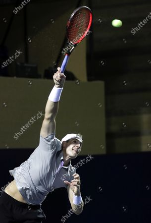 John Isner of the USA in action against Brandon Nakashima of the USA during the semi-final match of the Los Cabos Open tennis tournament in Los Cabos, Baja California Sur, Mexico, 23 July 2021.
