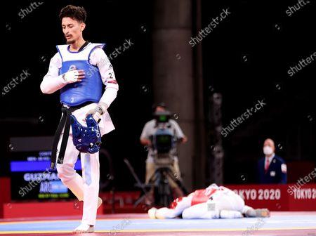Mens -58kg. Jack Woolley (red) vs Lucas Lautaro Guzman (blue). Lucas Lautaro Guzman of Argentina celebrates winning as Ireland's Jack Woolley lies dejected