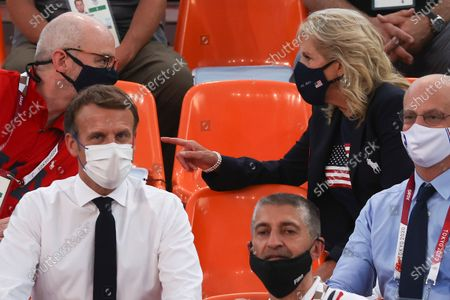 President of France Emmanuel Macron (L) and USA First Lady Jill Biden (top R) watch the Women's Pool Round match between France and the USA in the 3x3 Basketball events of the Tokyo 2020 Olympic Games at the Aomi Urban Sports Park in Tokyo, Japan, 24 July 2021.