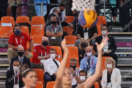 President of France Emmanuel Macron (bottom C) and USA First Lady Jill Biden (center 2-R) watch the Women's Pool Round match between France and the USA in the 3x3 Basketball events of the Tokyo 2020 Olympic Games at the Aomi Urban Sports Park in Tokyo, Japan, 24 July 2021.