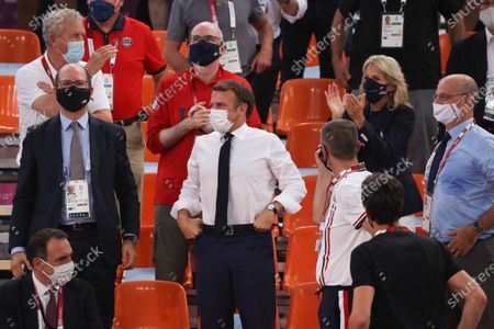 President of France Emmanuel Macron (C) and USA First Lady Jill Biden (2-R) watch the Women's Pool Round match between France and the USA in the 3x3 Basketball events of the Tokyo 2020 Olympic Games at the Aomi Urban Sports Park in Tokyo, Japan, 24 July 2021.
