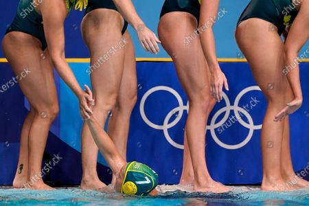 Stock Photo of Australia's Rowie Webster (7) celebrates with teammates after a win against Canada during a preliminary round women's water polo match at the 2020 Summer Olympics, in Tokyo, Japan