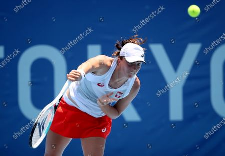 Stock Image of Iga Swiatek of Poland in action against Mona Barthel of Germany during their women's singles first round match of the Tokyo 2020 Olympic Games in Tokyo, Japan, 24 July 2021.