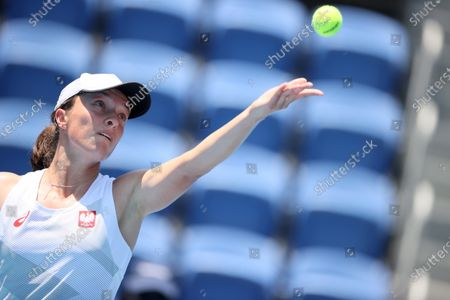 Iga Swiatek of Poland serves against Mona Barthel of Germany during their women's singles first round match of the Tokyo 2020 Olympic Games in Tokyo, Japan, 24 July 2021.