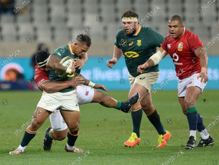 Elton Jantjies of South Africa is tackled by Mako Vunipola of BI Lions during the 2021 British and Irish Lions Tour first test between South Africa and BI Lions at Cape Town Stadium on 24 July 2021