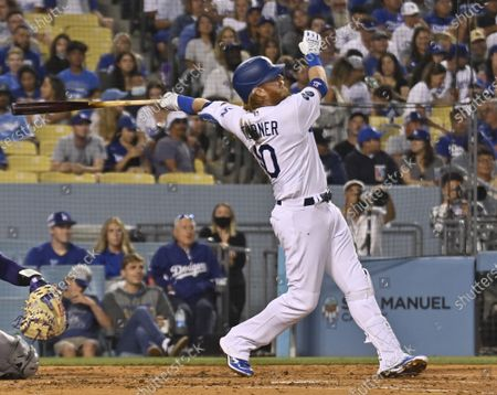 Stock Photo of Los Angeles Dodgers' Justin Turner hits his 18th homer of the season, a solo shot to left during the third inning off Colorado Rockies starting pitcher Chi Chi Gonzalez at Dodger Stadium in Los Angeles on Friday, July 23, 2021. The Rockies defeated the Dodgers 9-6, It was the Dodgers' third straight game in which the bullpen could not hold a late lead.