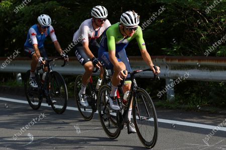 Stock Photo of Michael Woods, from left, of Canada, Brandon McNulty, of the United States and Tadej Pogacar, of Slovenia, compete in the men's cycling road race at the 2020 Summer Olympics, in Oyama, Japan