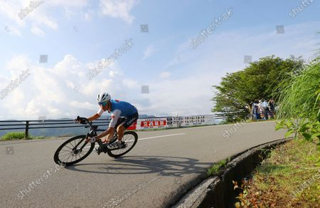 Michael Woods of Canada competes in the men's cycling road race at the 2020 Summer Olympics, in Oyama, Japan