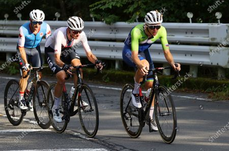 Michael Woods, from left, of Canada, Brandon McNulty of the United States and Tadej Pogacar of Slovenia compete in the men's cycling road race at the 2020 Summer Olympics, in Oyama, Japan