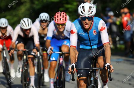 Stock Image of Michael Woods, of Canada, competes in the men's cycling road race at the 2020 Summer Olympics, in Oyama, Japan