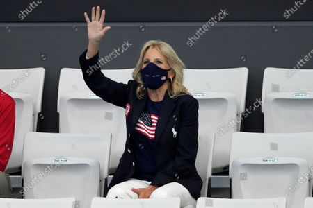 First Lady of the United States Jill Biden waves prior to the start of the swimming competition at the 2020 Summer Olympics, in Tokyo