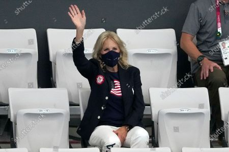 First lady of the United States, Jill Biden waves during a swimming event at the 2020 Summer Olympics, in Tokyo