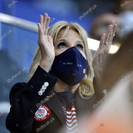 US First Lady Jill Biden observes the qualification round swimming heats during the Tokyo Summer Olympic Games in the Tokyo Aquatics Centre, on July 24, 2021.